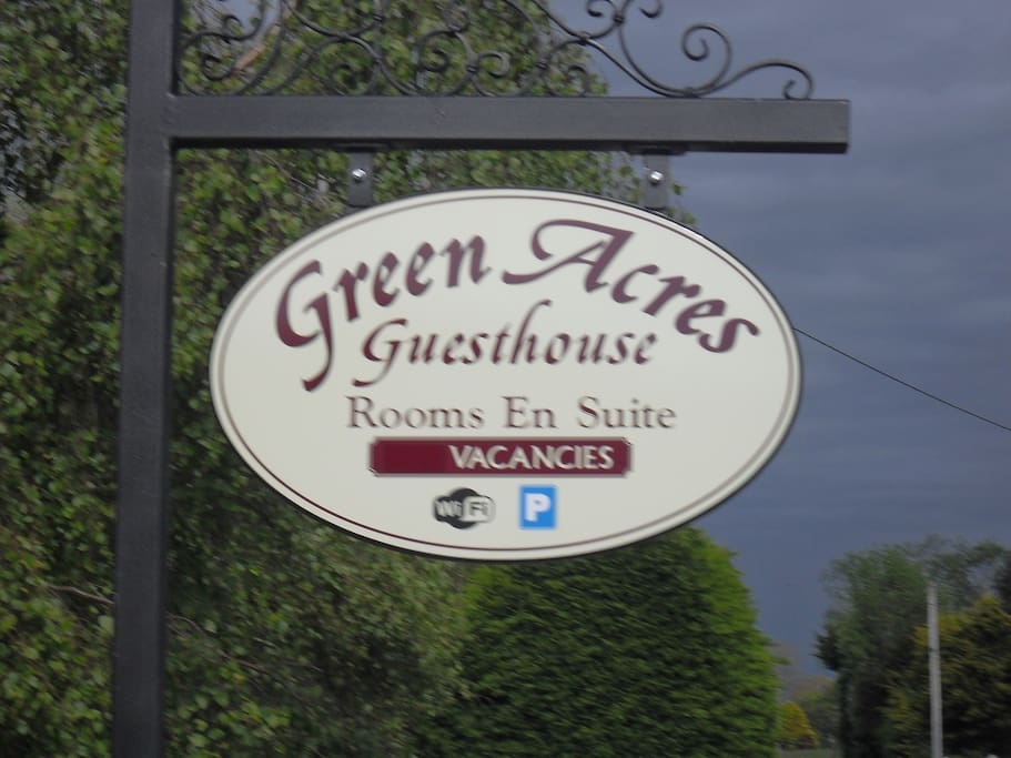 our guesthouse sign