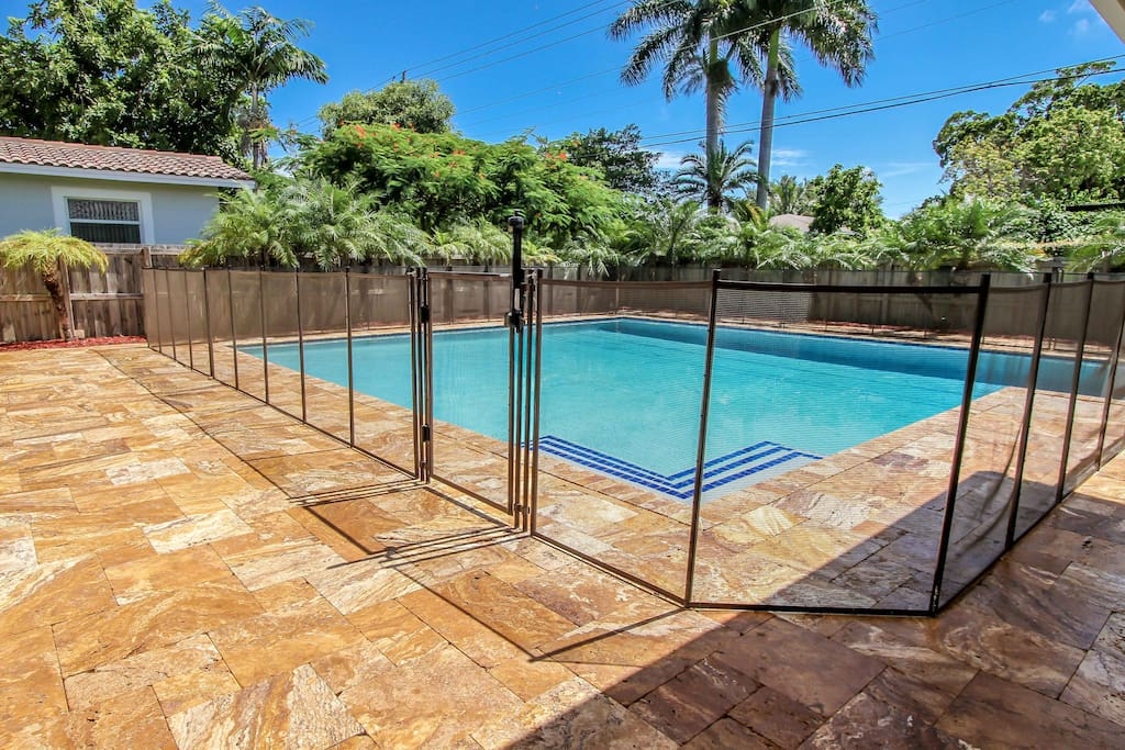 Pool with removable, lockable child-proof fence with gate.