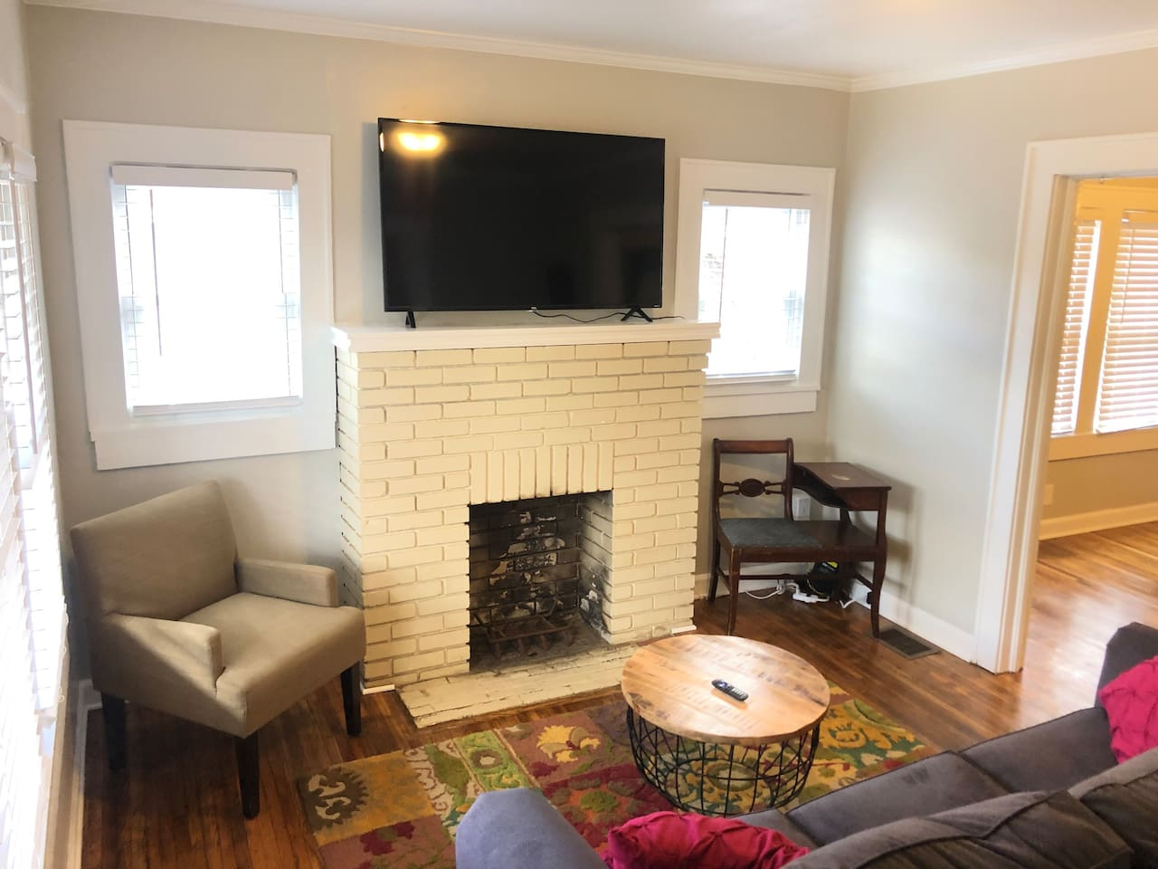 """Living room with 55"""" Roku Smart TV - lots of free programming and music and as well as Guests being able to sign into their own accounts."""