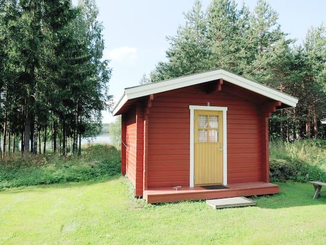 Tidy B&B cabin on a farm by a lake