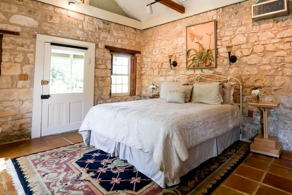 Fantastic king size bed set by a limestone wall