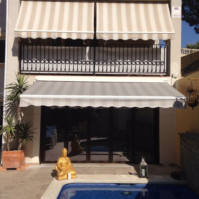 Looking at the main terrace with awnings and private salt water pool below.