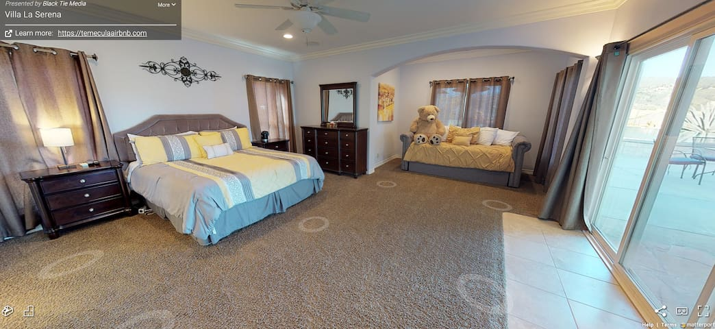M aster bedroom photo  with 1 king bed and 1 trundle bed