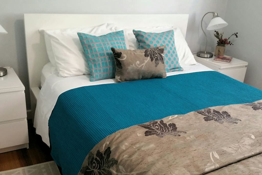 Queen size bed in separate bedroom with walk in robe