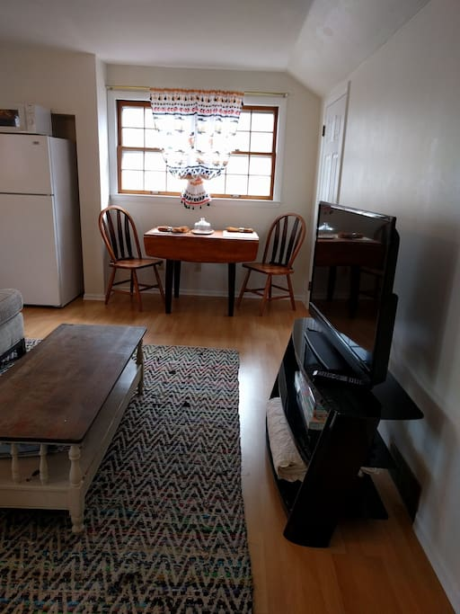 Kitchen dining table, couch, cozy chair, flat screen TV, Wifi