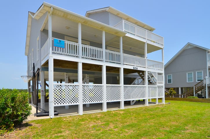 Relax and breathe in the salt air from the ocean facing front porch of this 2nd