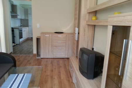 SUMMARY  This freshly renovated apartment can serve as a base for exploring the region or you can simply stay in, enjoy its serene atmosphere and the view on a big grass field just in front.