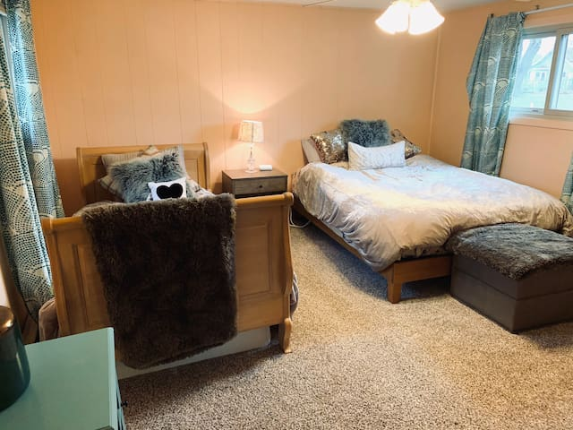 Newly carpeted Bedroom #2 is roomy enough for both a queen and a twin daybed.