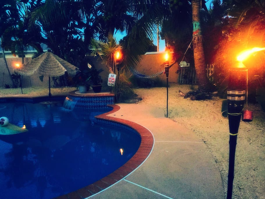 Tiki torches around the pool add nice mood lighting and keep the mosquitoes away!