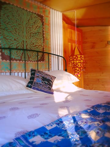 Out There - private en-suite yurt room with memory foam King Bed and organic linens.