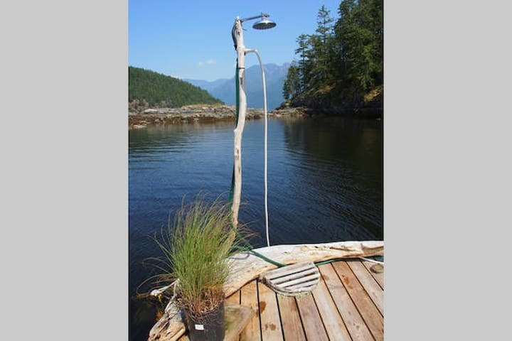Out There - fresh water dock shower to rinse off after a dip in the protected bay