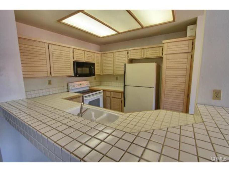 Kitchen with Refrigerator, Microwave, Oven, Dishwasher