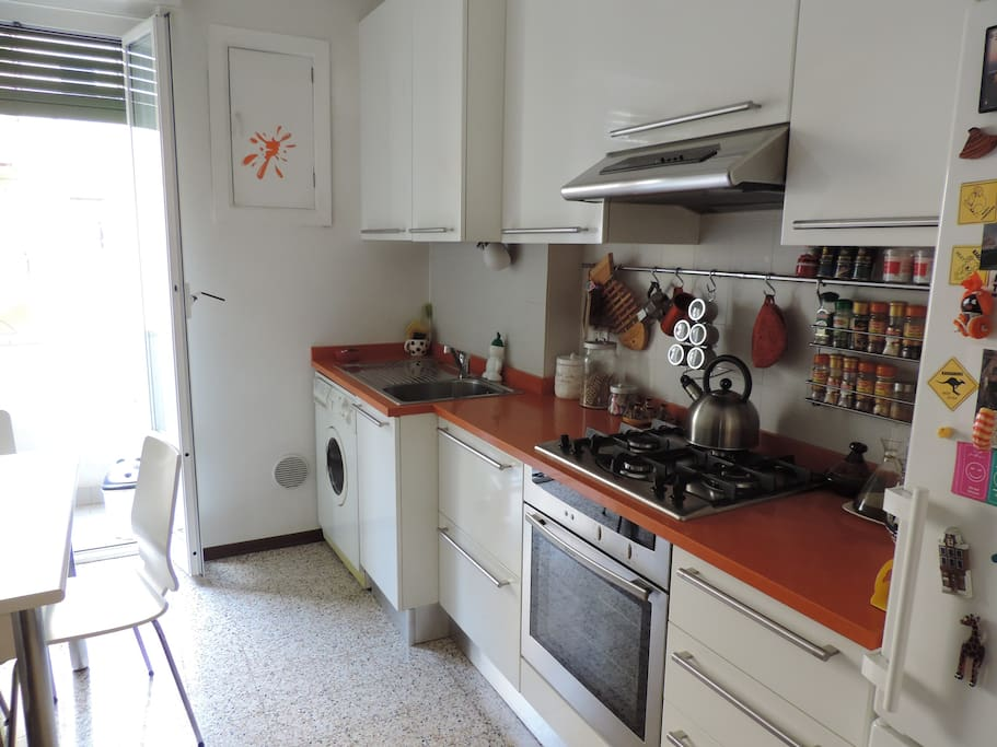 fully equipped kitchen  + dining table
