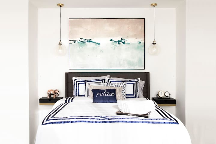 Enjoy a peaceful night in a queen bed with deluxe memory foam mattress, designer bedding and use of our iphone charging station.