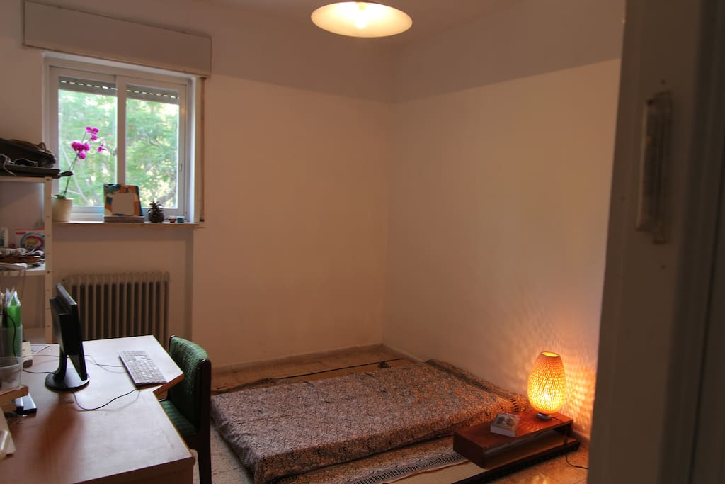 Tatami Mats and mattress, desk and bookcase.