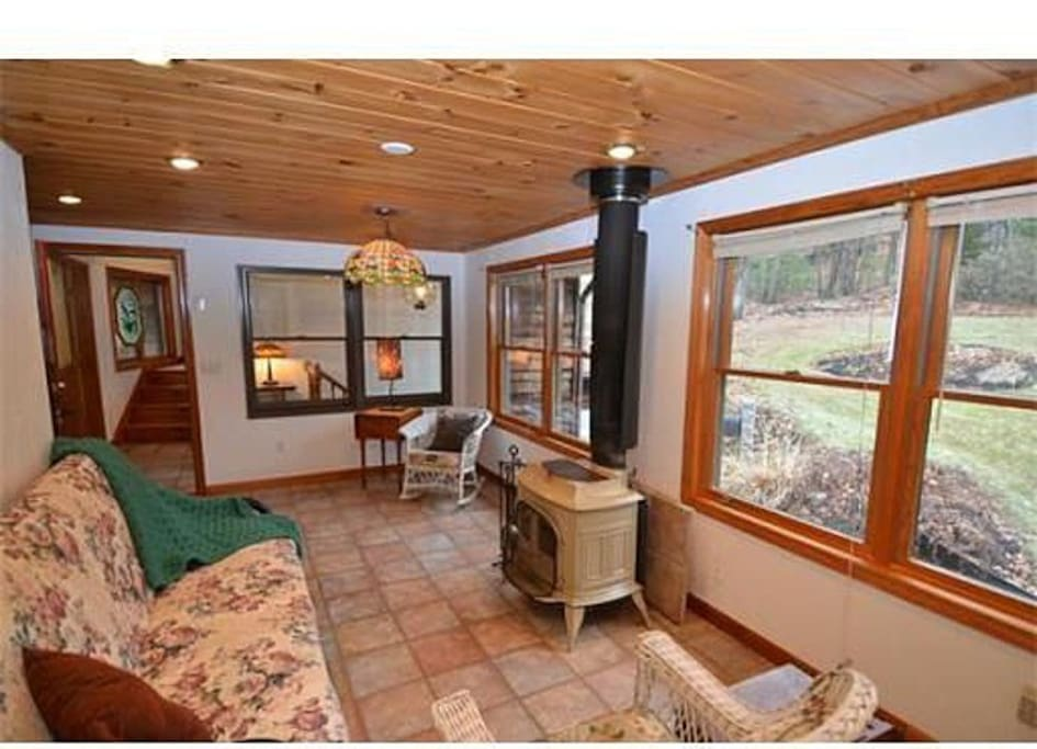 Sunroom with wood stove