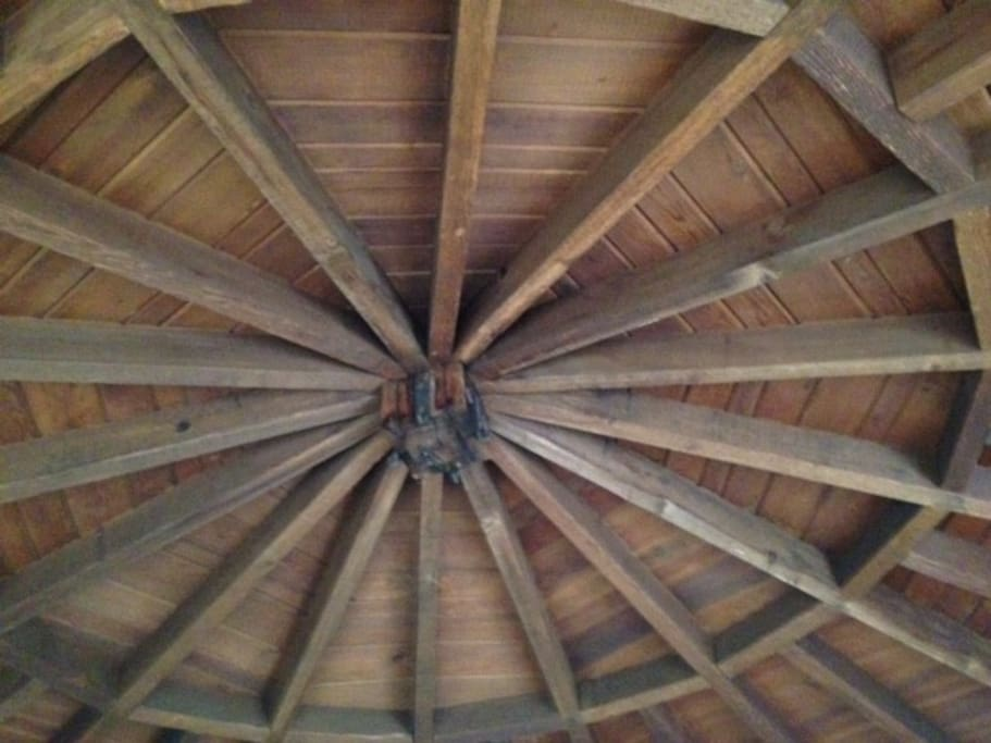 Built in 1932 beamed ceiling covering the main circular home.