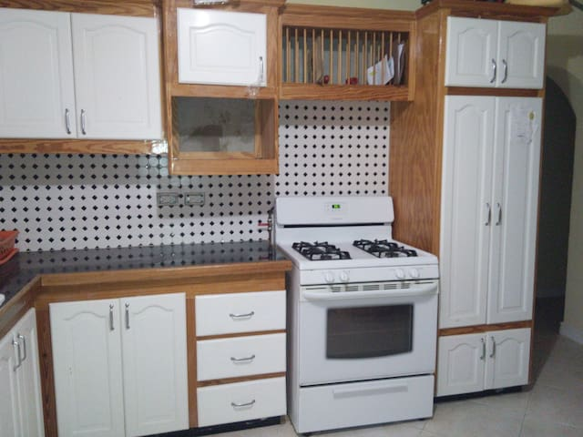 Kitchen, which includes a microwave and toaster and fridge