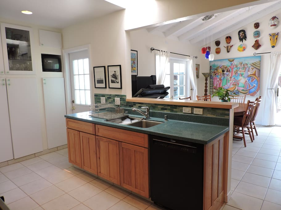 Well-lit Kitchen open to dining beyond