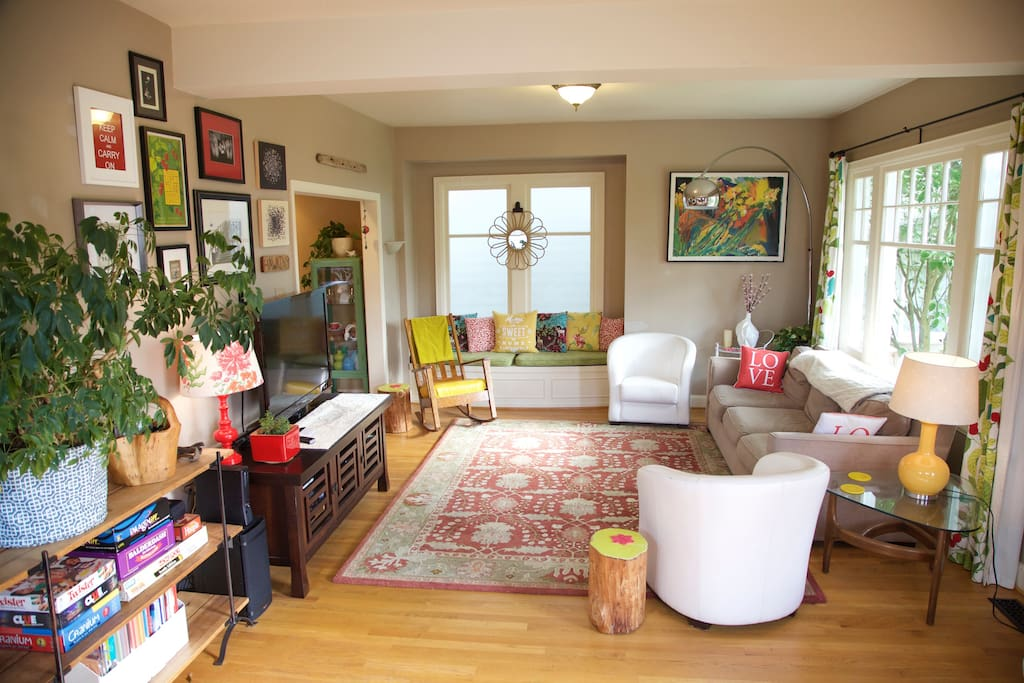 The large, open living room is our center of fun, with lots of color and afternoon sunshine.