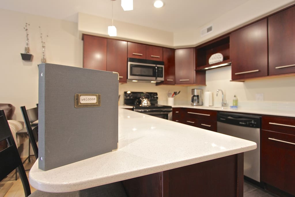 Beautiful kitchen with new full-size stainless steel appliances, including dishwasher