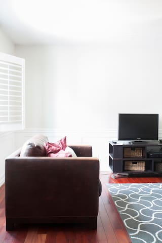 Plantation shutters and wainscoting invite you to relax and and unwind.