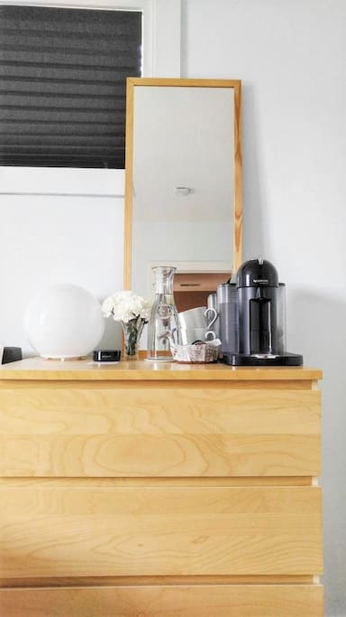 Dresser, Nespresso coffee machine, Amazon Echo, water carafe