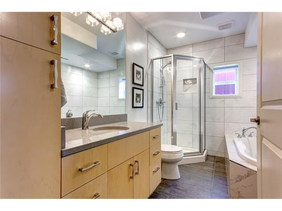 Bathroom with shower, jetted tub and heated floor.