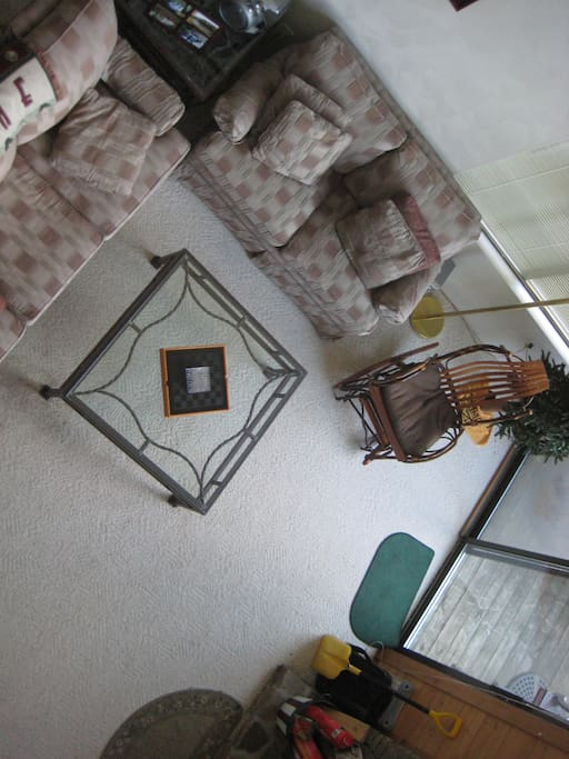 Arial view of the living room from the upstairs loft with a sofa bed