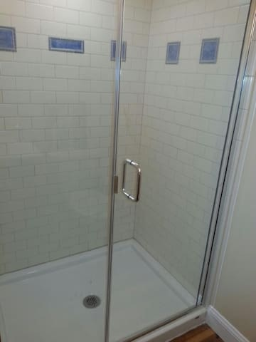 Private Subway tile walk in shower.
