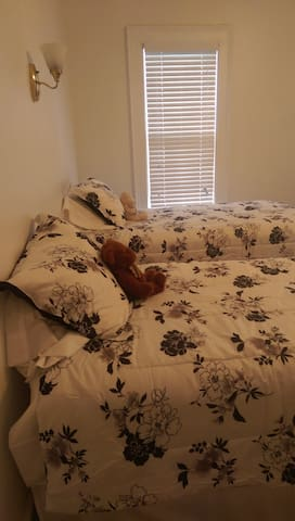 Second bedroom with two twin beds that can be converted into a King upon request.