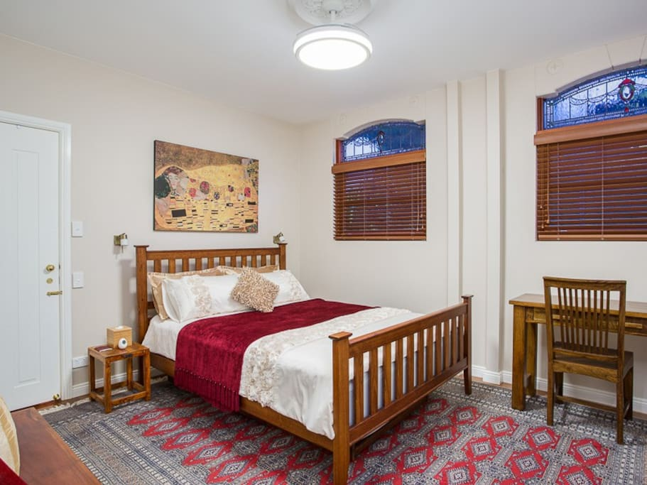 Guest Bedroom with 1 Queen Bed as well as single bed Trundle if required, Built In Wardrobe, TV, Apple TV, Music, Ceiling Fan, Aircon/Heating