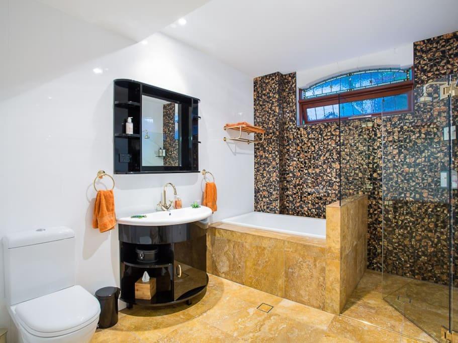 Guest Ensuite with Shower, deep Bath, Toilet, large Basin, Towels, Hairdryer etc
