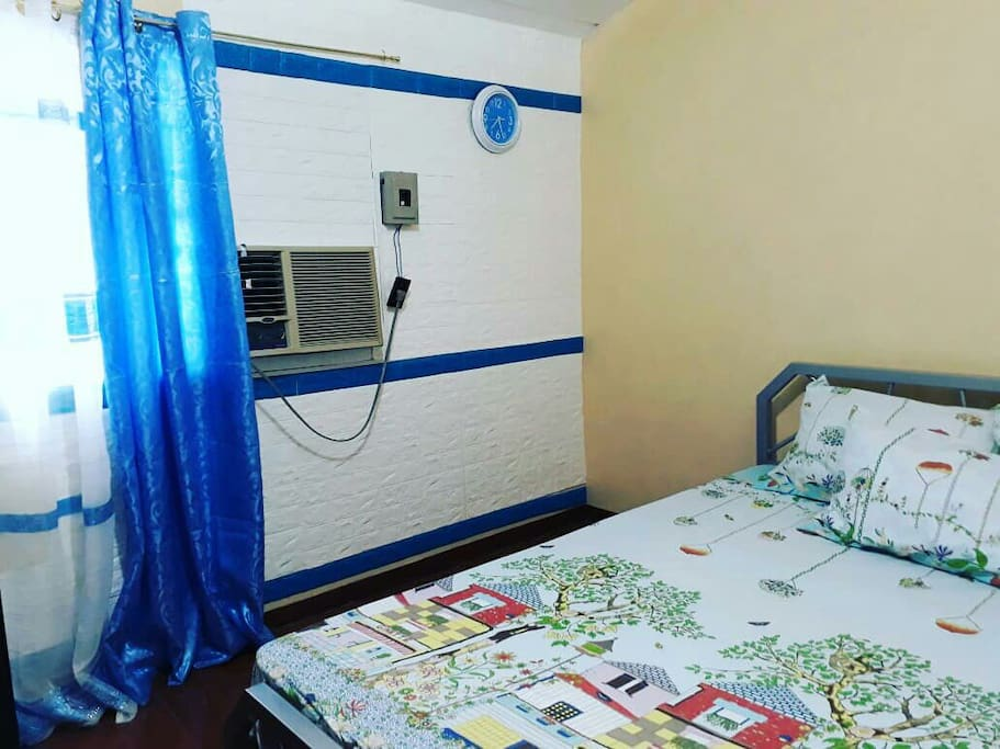 Second floor: Queen bedroom.aircon, good for 3 pax, Queen size bed with pull out, spacious cabinet.