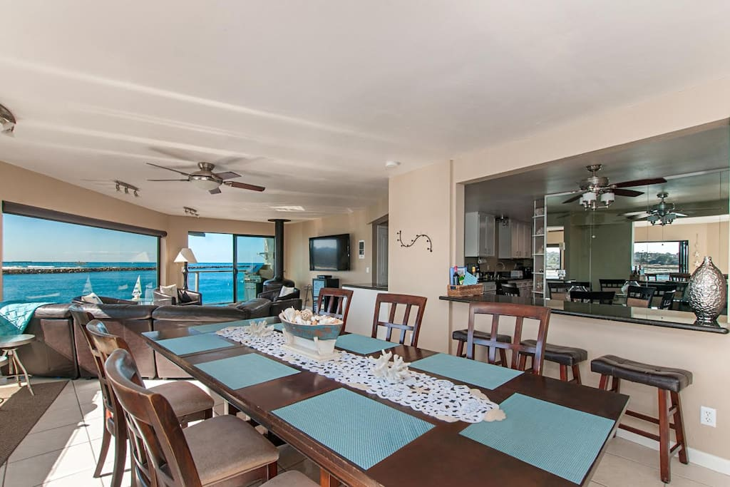Large dining table can seat 10 to 12 guests  all while enjoying the ocean views.