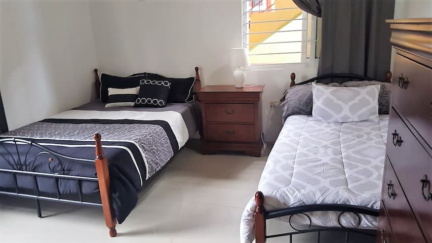 Beautiful Bedroom with 2 beds for 3 guests.
