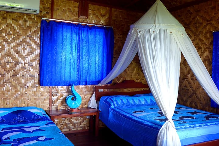 The delightful sea view bungalow with one double spring bed and one single bed. Suitable for 2 or 3 guests.