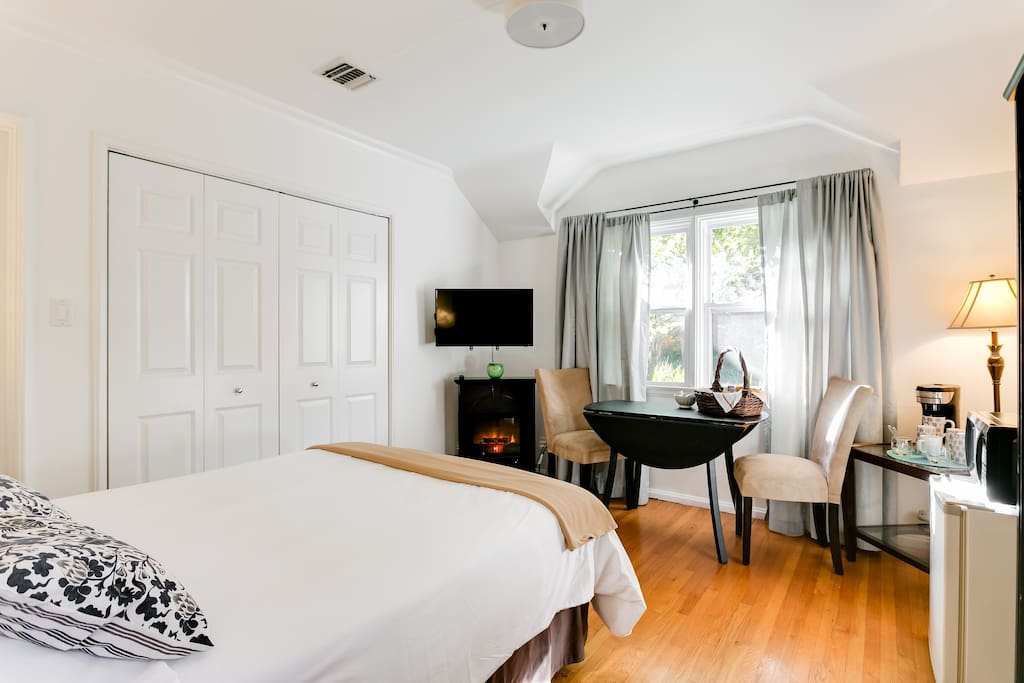 Enjoy the Flat Screen TV with Roku, Hulu and many other channels from your comfy bed or sitting area, along with the warmth and lovely ambiance of the petite electrical fireplace.