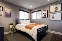 Bedroom two features a brand new queen size bed, a full size dresser,  and plenty of closet space to accommodate your things.  There is also a desk in the event you should need to get some work done during your stay.