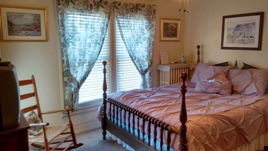 Antique Queen Bedroom with Private Bathroom outside the room in the hall.