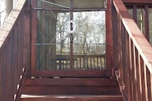 Entrance through 2-tier Screened Deck
