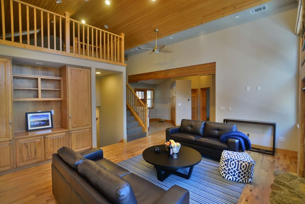 Gorgeous great room with high faulted ceilings and loft