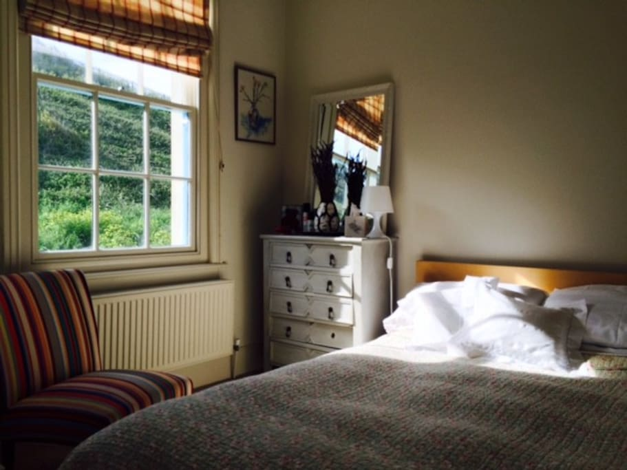 The guest room sees the morning sun and has great views up the East Hill