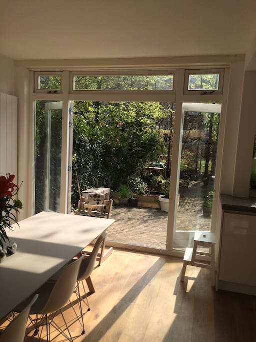 Dining room with doors opening to the sunny garden