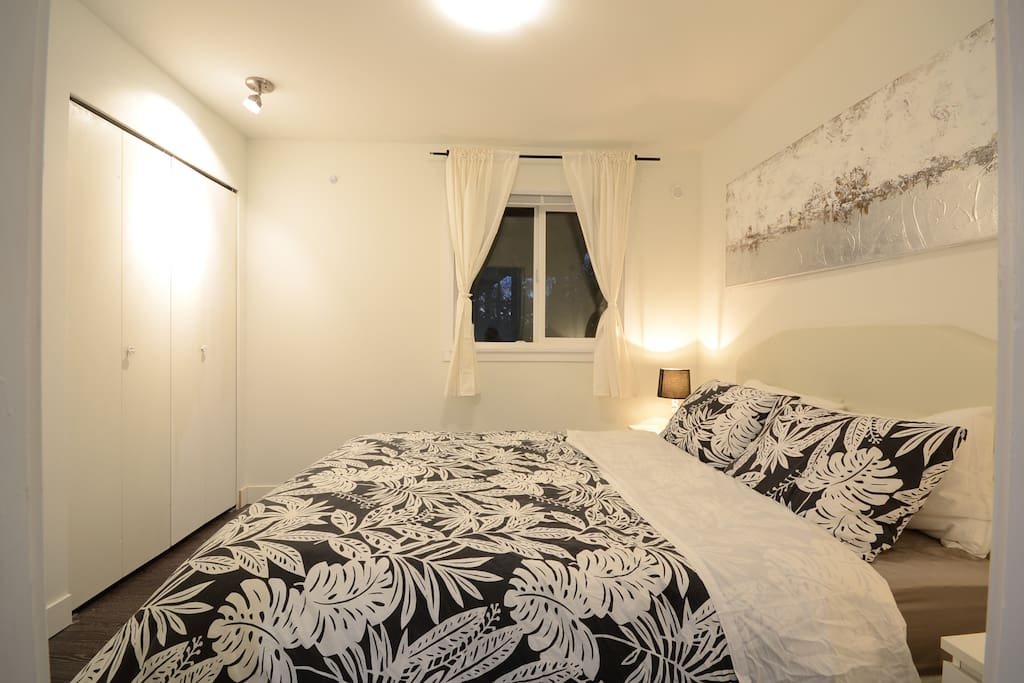 Cozy, private, bedroom with closet that has built-in shelving
