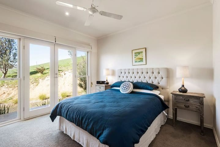 Queen size bed and french doors to balcony