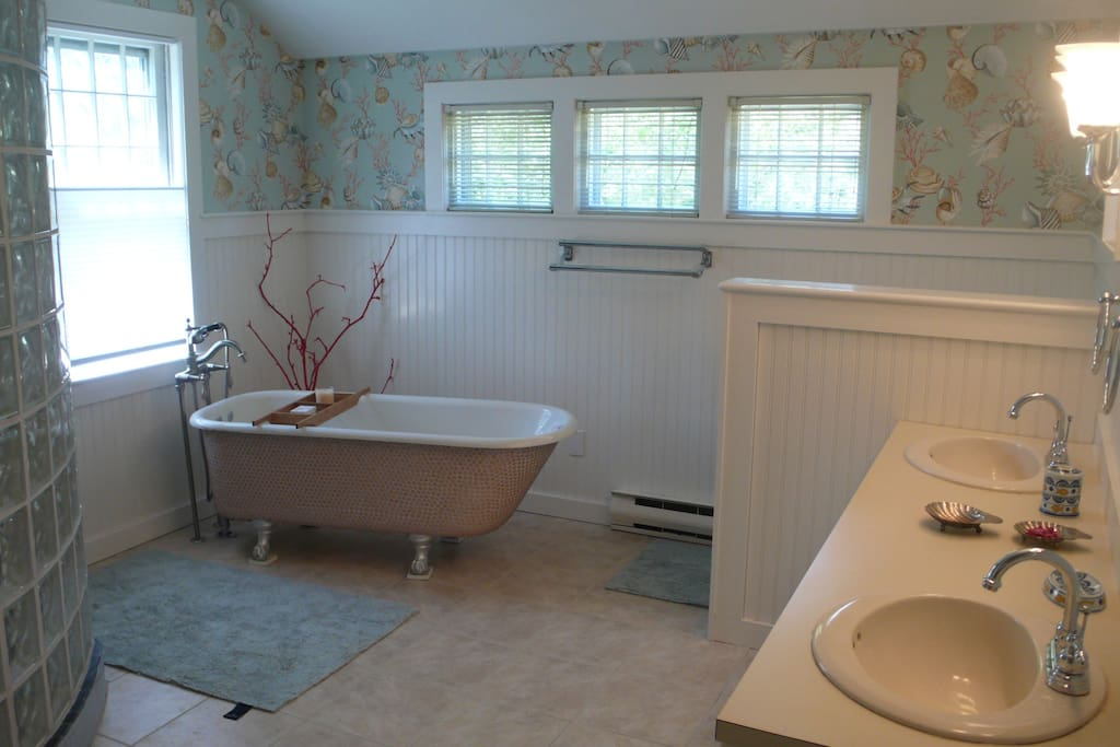Bath and separate shower feature in this bathroom, one of two full bathrooms
