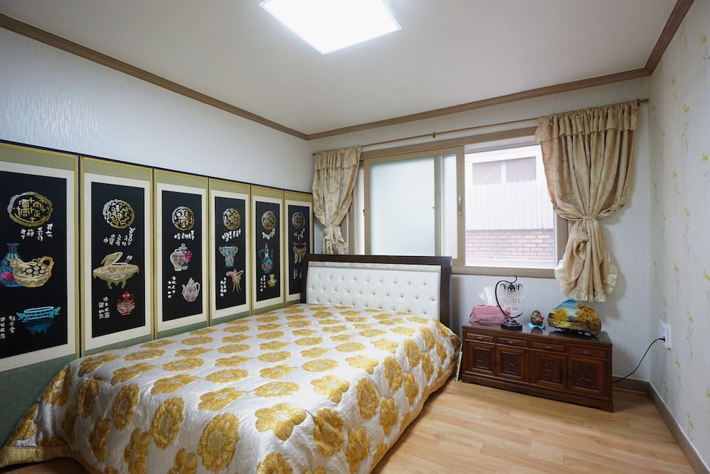 Queen bed for couple with Needle work folding Screen.