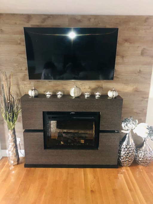 "Electric fireplace and 65"" smart tv, fire stick and ummu app to watch hundreds of movies and TV shows."