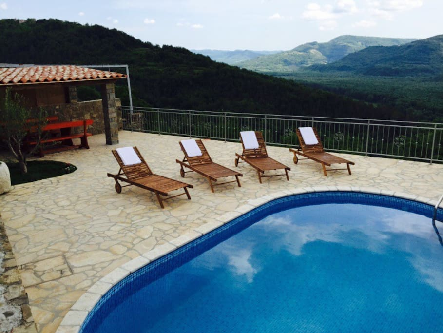 Pool situated in the garden. Since the house is on hilltop there is fantastic open panorama. Enjoy swimming while feeling like flying!